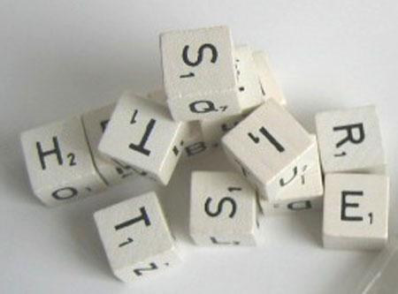 Buchstabenwürfel aus Holz im Polybeutel